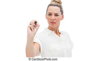 Concentrated businesswoman writing something with pen