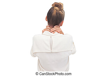 Businesswoman with hand on her neck