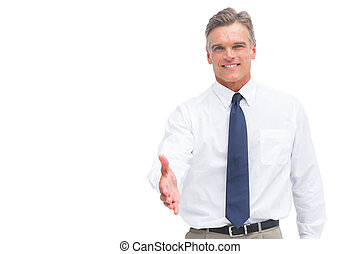Smiling mature businessman ready to shake hand to someone