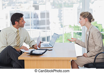 Businessman interviewing a businesswoman in the office