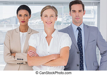 Group of business people standing in front of the camera