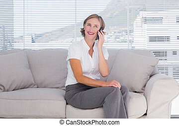 Pretty businesswoman talking on phone