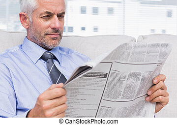 Businessman reading the news in office
