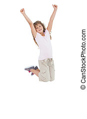 Little girl jumping and putting her hands up