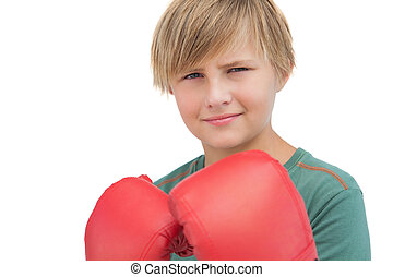 Smiling boy with boxing gloves