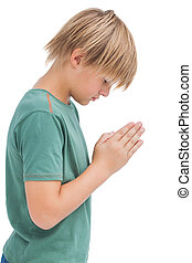 Little boy praying with bowed head on white background