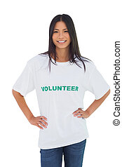 Cheerful woman wearing volunteer tshirt on white background