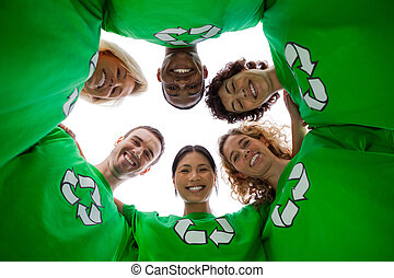 Low angle view of people wearing green shirt with recycling...