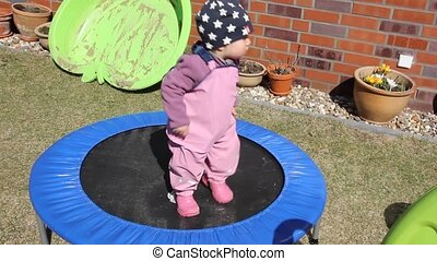 Little girl on the trampoline - Little girl one year and...