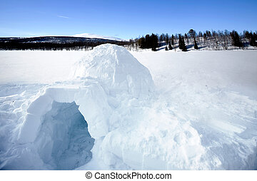 Igloo - An igloo on a frozen lake in the mountains