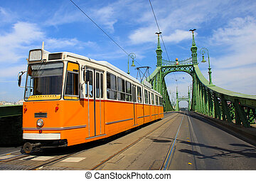 Tram coming from Freedom bridge, Budapest, Hungary