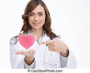 Doctor holding and pointing at a pi - Attractive doctor...