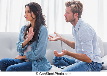 Woman gesturing while quarreling with her partner in the...