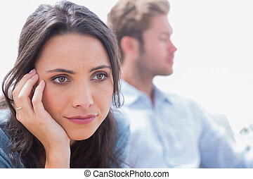 Thoughtful woman holding her head