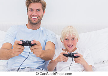 Father and son having fun playing video games