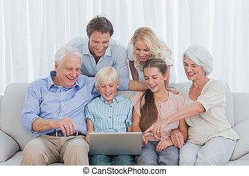 Extended family sitting on sofa