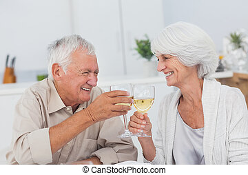 Couple toasting with white wine