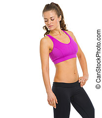 Fitness young woman looking down on copy space