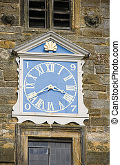 Church clock - A blue clock on church tower