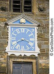 Church clock - A blue clock on church tower