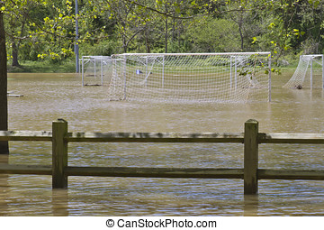No Soccer Due to Flood - A soccer field with nets flooded by...