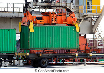 crane container - Harbor crane lifting a sea container