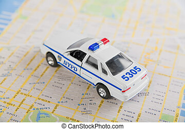 NYPD car and road map. Closeup, selective focus.