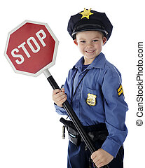 "The Cop Says Stop - An adorable young ""policeman"" happily..."