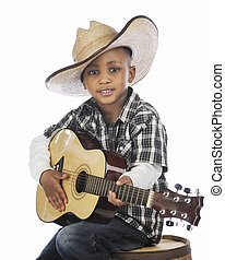 Young Strumming Cowboy - A happy elementary cowboy strumming...