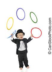 Tiny Juggler - An adorable, barefoot toddler juggling...