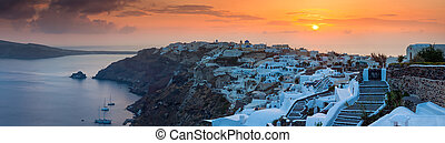 Sunset Over Oia Santorini - Panorma of the sun settings over...