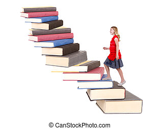 teen climbing a staircase of books - young teenage girl...