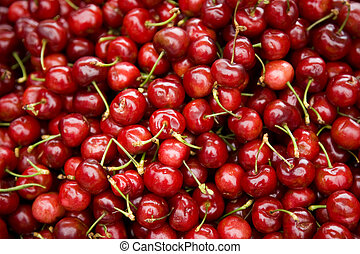 Cluster of Fresh Cherries at a Farmers Market