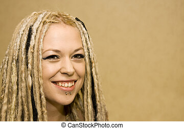 Smiling Woman with Face Piercings and Dread Lock Hair