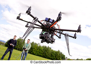 Photographer and Pilot with UAV - Photography UAV being...