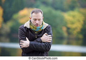 Man Freezing From Cold - Mature man in jacket freezing from...