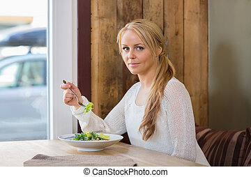 Pretty Woman With Plate Of Salad In Cafe
