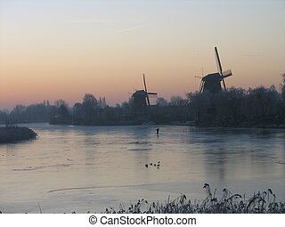 Lonely skater & windmills - Sunrise with windmills and...