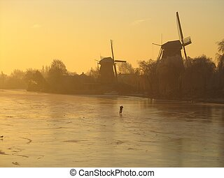 Sunrise, skater & windmills - Flamboyant sunrise with...