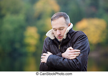 Mature Man Shivering - Mature man in jacket shivering...