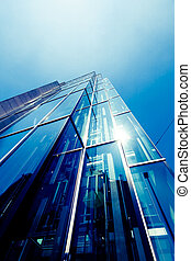 exterior of glass residential building. Modern glass silhouettes of skyscrapers