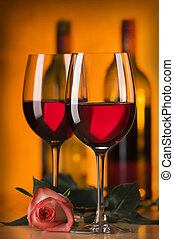 wine - glass of red wine with rose close up shoot