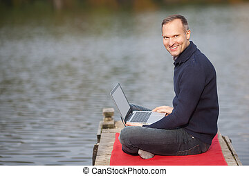 Smiling Man With Laptop Outdoor