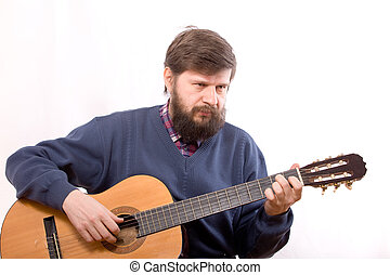 The man playing on guitar