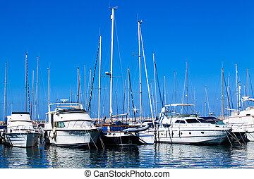 boats in harbor.  Boats bow in marina