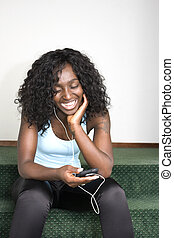 Young African American Female Listening to Music - Young...