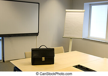 Briefcase in Board Room with White Board