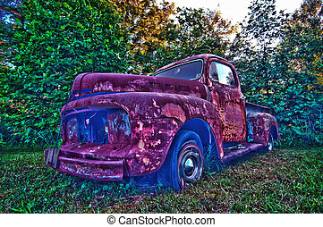 old vehcle hdr - abandoned rusty vehicle on the farm lawn