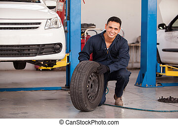 Happy mechanic loving his job - Handsome young mechanic...