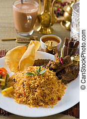 Biryani  rice with traditional items on background